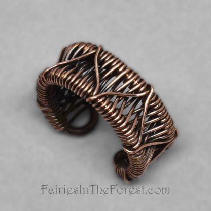 Zigzag weave copper ear cuff.