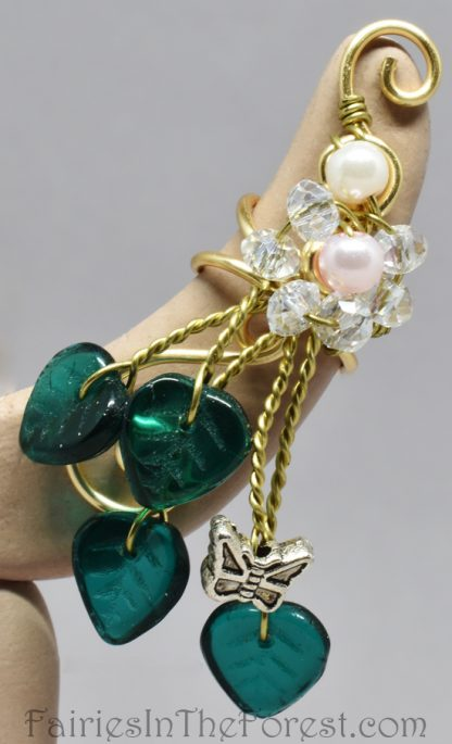 Handmade fairy ear cuff with glass pearls, crystals, green glass leaves and a silver butterfly.