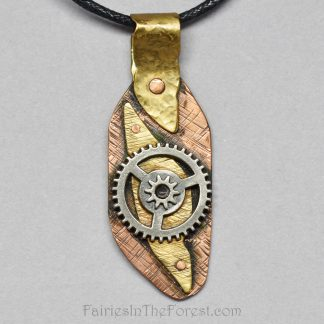 Copper and brass steampunk pendant on a black cotton necklace.