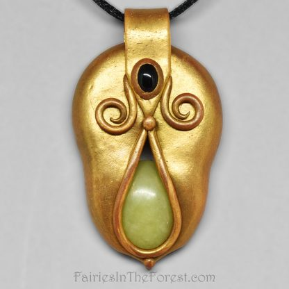 Gold polymer clay pendant with green serpentine and black onyx.