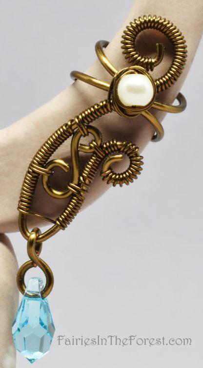 Vintage brass and blue Swarovski crystal fairy style handmade ear cuff.