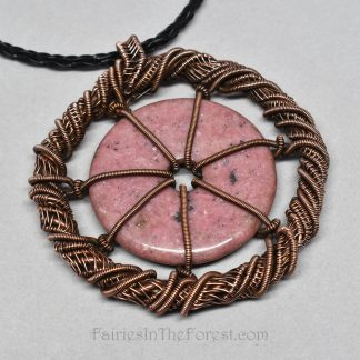 Copper and Rhodonite gemstone donut necklace.