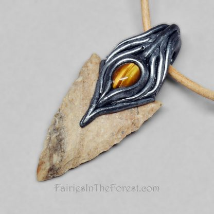 Polymer clay and flint arrowhead pendant with Tigereye on a tan leather necklace.