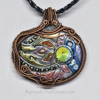 Polymer clay and copper wire wrapped necklace.