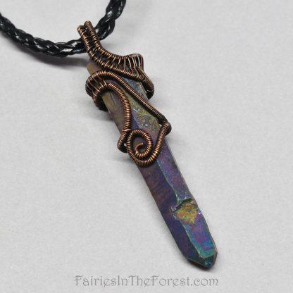 Copper wire wrapped titanium Quartz pendant.