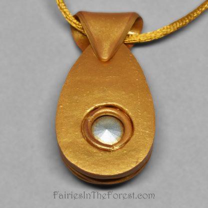 Gold polymer clay and rainbow crystal rivoli pendant.