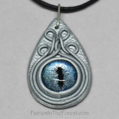 Blue dragon eye in silver polymer clay necklace.