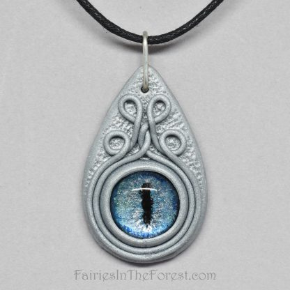 Blue dragon eye in silver polymer clay necklace.
