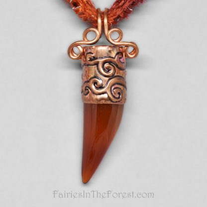 Copper and Red Agate claw pendant on a burgundy and orange necklace.